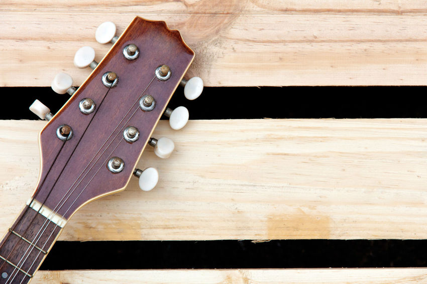 mandolin headstock background Background Brown Close-up Day Indoors  Mandolin Mandolin Strings Music Musical Instrument Musical Instrument String No People Table Wood - Material