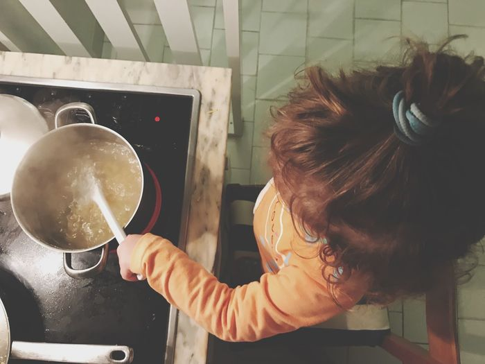 Kid Cooking Children Cooking Domestic Kitchen Indoors  Real People One Person Preparation  Food And Drink Domestic Room Preparing Food Kitchen Domestic Life Stove Directly Above Food Lifestyles Childhood Learning Freshness Mixing Day Close-up