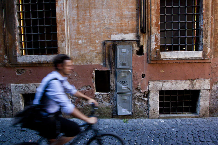 a cyclist in Rome EyeEmNewHere Road Roma Bicycle Cycling Man Made Rome Italy Street Streetphotography