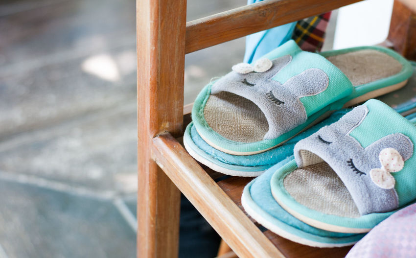 High angle view of slippers on wooden rack