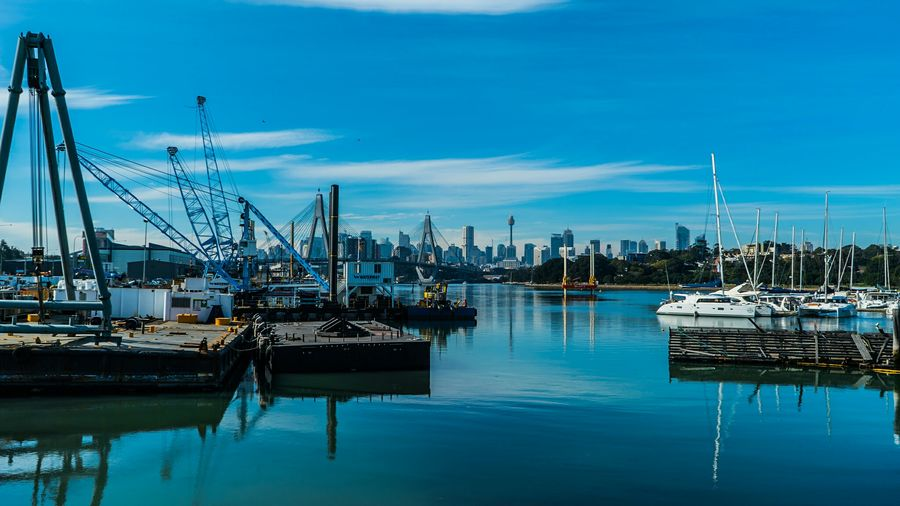 Dockyard At Sydney Harbor Against Blue Sky
