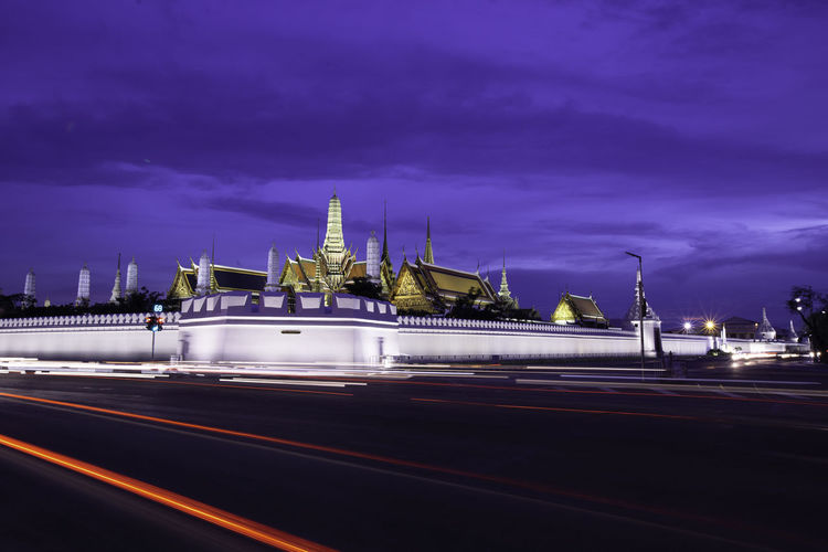 Temple of the Emerald Buddha.(Wat Phra Kaew.) Bangkok, Thailand with twilight time Bangkok, Thailand Emerald Buddha Temple Twilight Time Wat Phra Kaew Architecture Building Exterior Built Structure City Cloud - Sky Dusk Illuminated Light Trail Long Exposure Mode Of Transportation Motion Nature Night No People Outdoors Road Sky Speed Street Temple Transportation