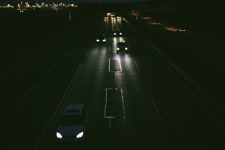 High angle view of vehicles on road at night