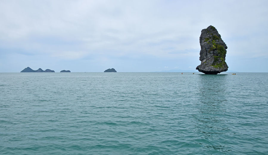 Seascape at Ang Thong National Marine Park of Thailand Ang Thong National Marine Park Angthong Blue Blue Wave Calm Day Horizon Over Water Idyllic Nature Rock Rock - Object Rock Formation Scenics Sea Seascape Sky The KIOMI Collection Tranquil Scene Tranquility Water Waterfront The Great Outdoors With Adobe Been There.