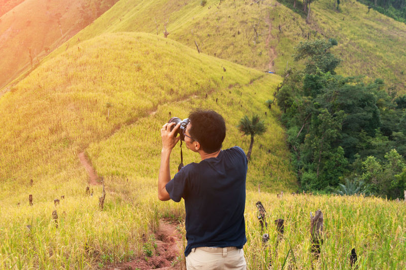 Man Photographing With Camera On Landscape