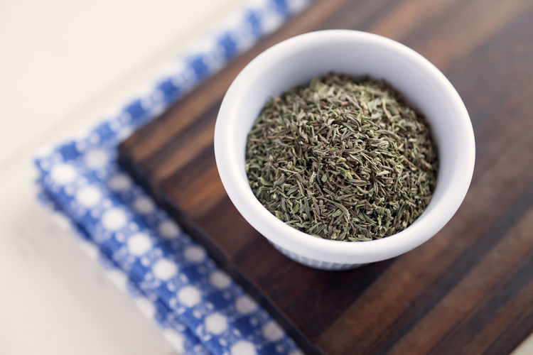 High Angle View Of Dried Thyme In Bowl On Table