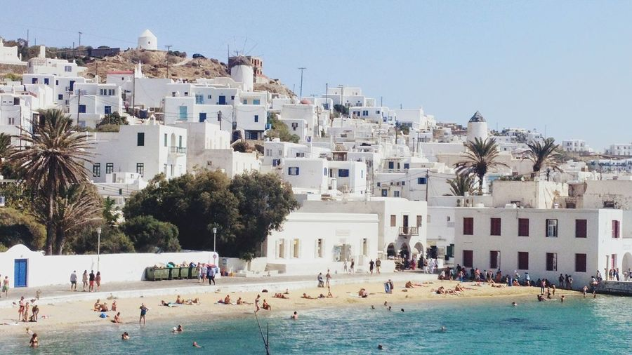 Always In Summer Mood Beach Life Mykonos,Greece Mykonos Island Summer Memories 🌄 White Architecture Sea And Sky My Hurt Is Summer Large Group Of People Building Exterior Built Structure Tree Outdoors Day Vacations Swimming People Adult