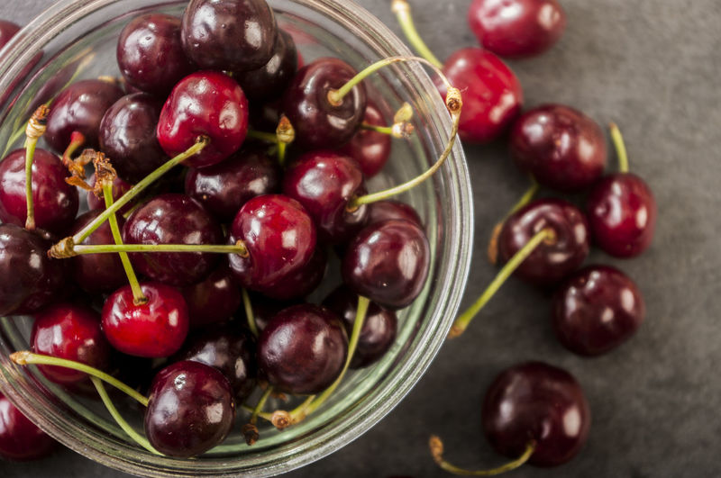 Directly Above Shot Of Cherries In Glass Bowl On Table