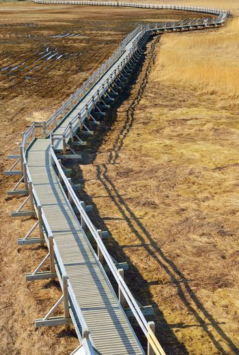 High angle view of metal railing on field