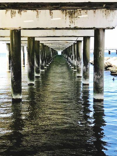 Under the bridge Water Architecture Built Structure Architectural Column Pier Connection No People Waterfront Underneath Reflection Colonnade