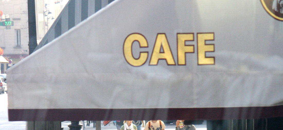A Taste Of Paris Architecture Building Exterior Built Structure Cafe Sign Café In Paris Capital Letter Close-up Communication Day Indoors  No People Rain Awning Text Western Script