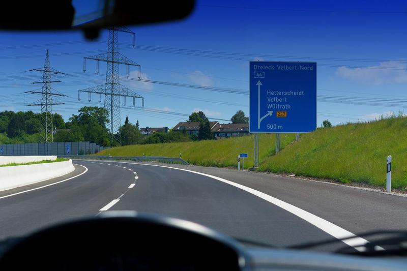 German motorway sign with inscription in German Driving direction to the cities - Velbert, Heiligenhaus, Wuelfrath and Hetterscheidt #NotYourCliche Love Letter
