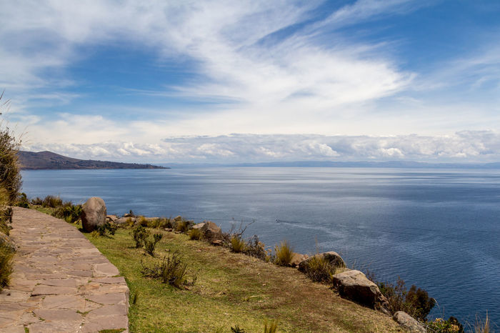 Photograph from the top of Taquile island of the blue and calm waters of Titicaca lake in Puno, Peru. Adventure Andes Calm Cloud Enjoy Freedom Holiday Immense Island Lake Landscape Nature Peace Peaceful Peru Peruvian Puno Relax Rocks Sky Taquile Titicaca Travel Water Neighborhood Map