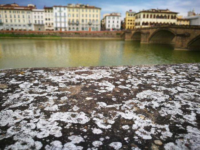 Retaining Wall Against Ponte Vecchio Over Arno River In City