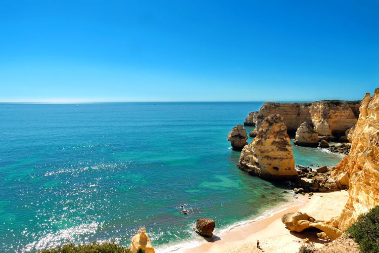 Praia da Marinha, perfect for a lazy day at the beach and enjoying life and nature Coastline Discover Your City Holiday Nature Praia Da Marinha, Algarve Stunning Swimming Travel Beach Blue Enjoy Life Explore Horizon Over Water Lazy Leisure Activity Nature Outdoors Paradise Rocks Sea Sky Stunning View Turquoise Colored Vacation Wild