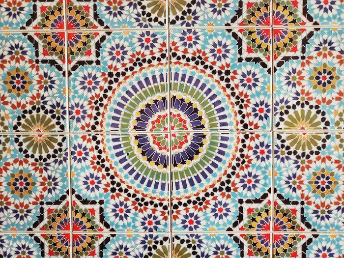Directly below shot of multi colored tiled floor