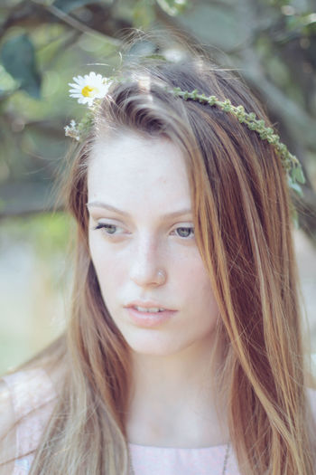 Candid. Contemplation Daisy Daisy Flower Flower Crown Front View Girls Lifestyles Long Hair Person Portrait Real People Serious Young Adult Young Women Natural Light Portrait