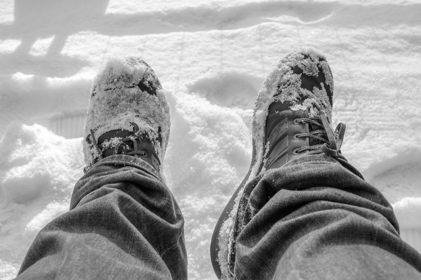 Snow covered shoes. Snow Covered Snow Lifestyle EyeEm Selects Shoe Personal Perspective Low Section Human Leg Human Body Part Real People One Person Day Lifestyles Men Outdoors Close-up Nature People Colour Your Horizn
