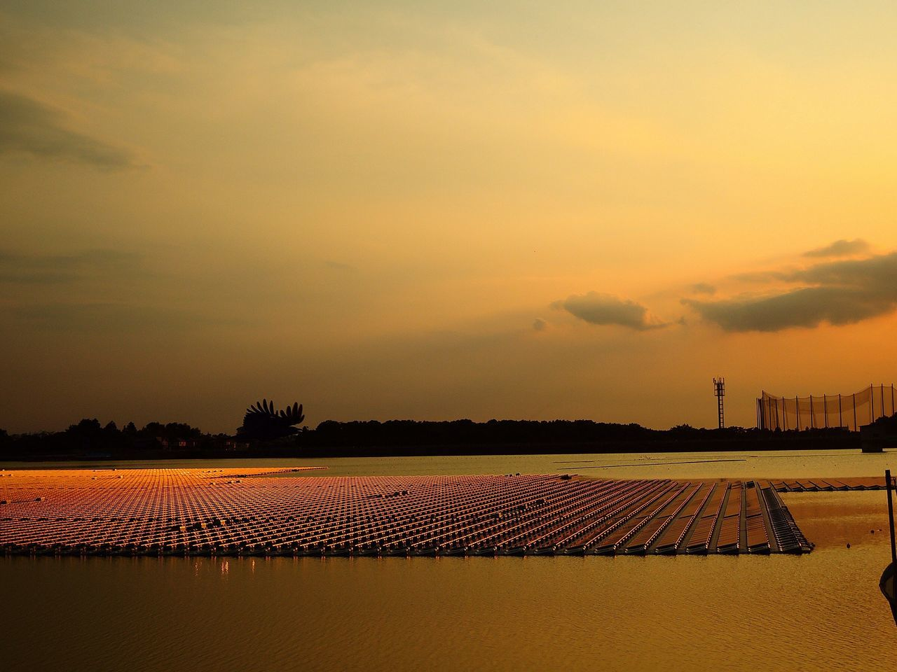 Silhouette Of Floating Solar Panel On River