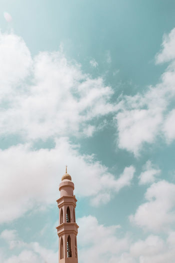 Oman Chapters Cloud - Sky Built Structure Architecture Sky Building Exterior Low Angle View Building Tower No People Nature Place Of Worship Religion Belief Travel Destinations Spirituality Tall - High Day Outdoors Travel Tourism Spire
