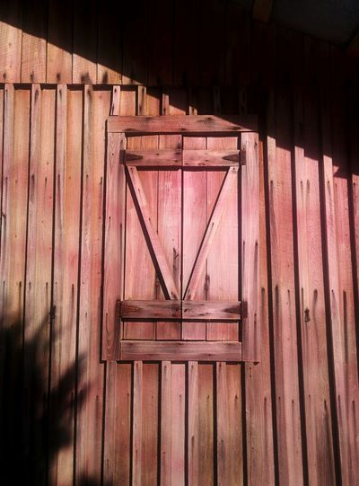 Low Angle View Of Closed Window On Wooden Building