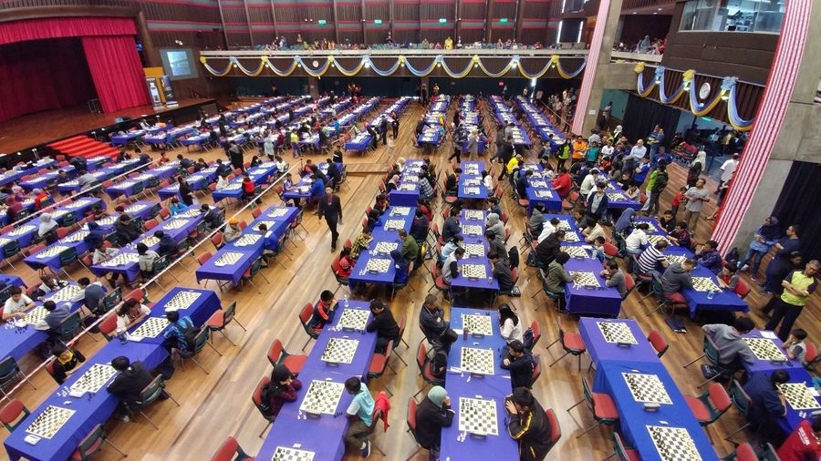 During the chess tournament Chess Tournament Players Fighters Fighting BIG War Small People High View Stadium City Politics And Government High Angle View