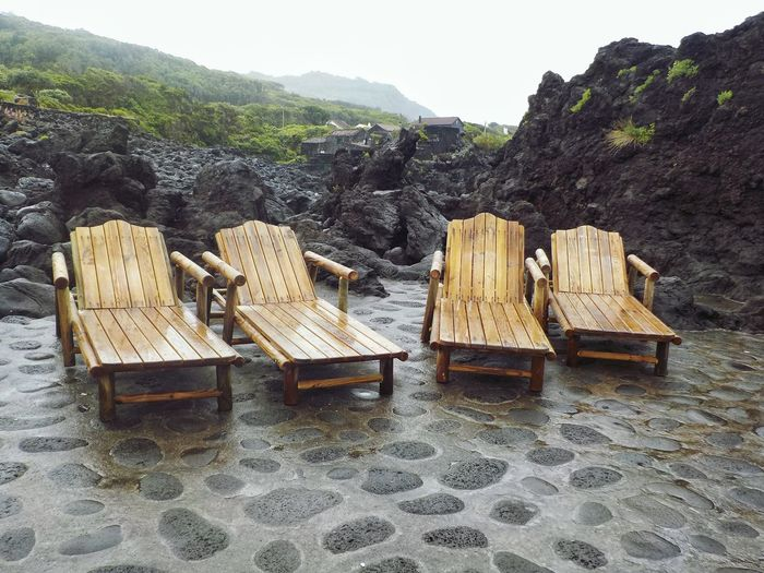 Sunbading in the rain Beach Chair Sunbading Stack Wood - Material Timber Log Lumber Industry Hooded Beach Chair Rock Formation