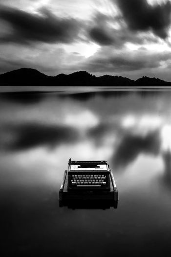 typewriter in the lake Beauty In Nature Cloud - Sky Dusk Lake Mountain Mountain Range Nature No People Non-urban Scene Outdoors Reflection Retro Styled Scenics - Nature Sky Tranquil Scene Tranquility Water Waterfront