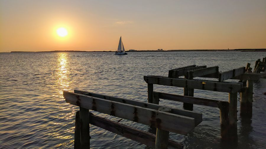 Water Nautical Vessel Sea Sunset Clear Sky Beach Harbor Relaxation Sunlight Wood - Material Romantic Sky Atmospheric Mood