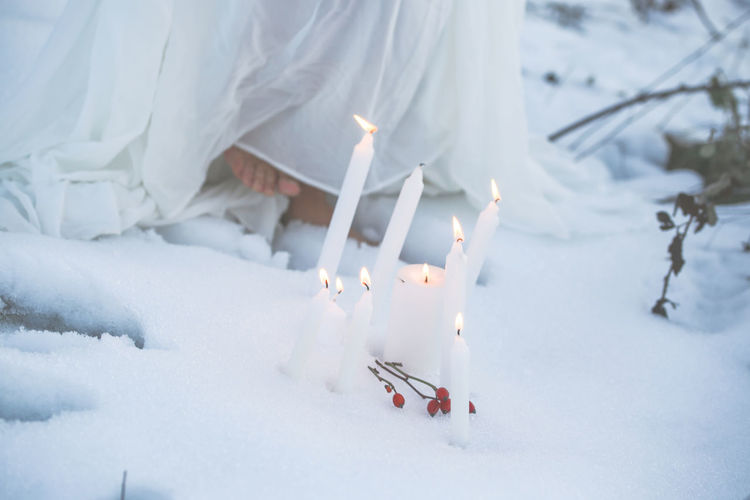 She walks in beauty barefoot Barefoot Lifestyle Snow Water Feet Candles Candlelight Wintertime Winter Wonderland Rosehips Flame Burning Fire Winter Cold Temperature Candle White Color Illuminated Imbolc Candlemas Spirituality SPIRITUAL HEALING