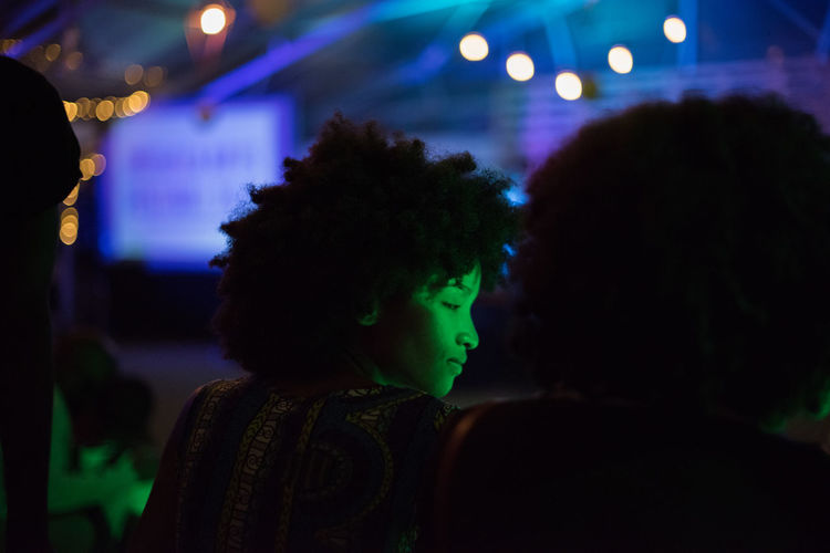 Afro twins Afro Adult Adults Only Arts Culture And Entertainment Celebration Focus On Foreground Friendship Headshot Illuminated Indoors  Leisure Activity Lifestyles Night Nightclub Nightlife People Popular Music Concert Real People Togetherness Two People Young Adult Young Women Youth Culture