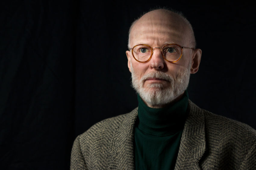 portrait of mature man adult expressive Adult Adults Only Beard Black Background Close-up Eyeglasses  Filtered Light Front View Headshot Mature Adult Mature Men One Man Only One Person Only Men People Portrait Real People Studio Shot Sweater Venetian Blinds Window Light