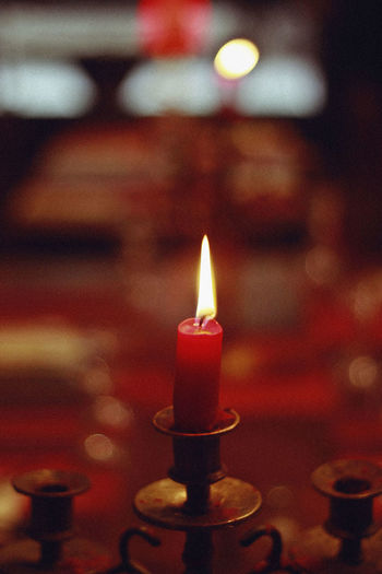 Candle, 2018 Candle Christmas Red Belief Burning Candle Candlestick Holder Close-up Electric Lamp Fire Fire - Natural Phenomenon Flame Focus On Foreground Glowing Heat - Temperature Illuminated Indoors  Lighting Equipment Melting No People Oil Lamp Place Of Worship Religion Selective Focus Spirituality