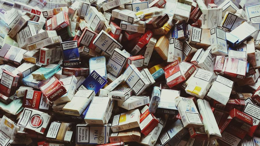 Extreme close up of cigarette boxes