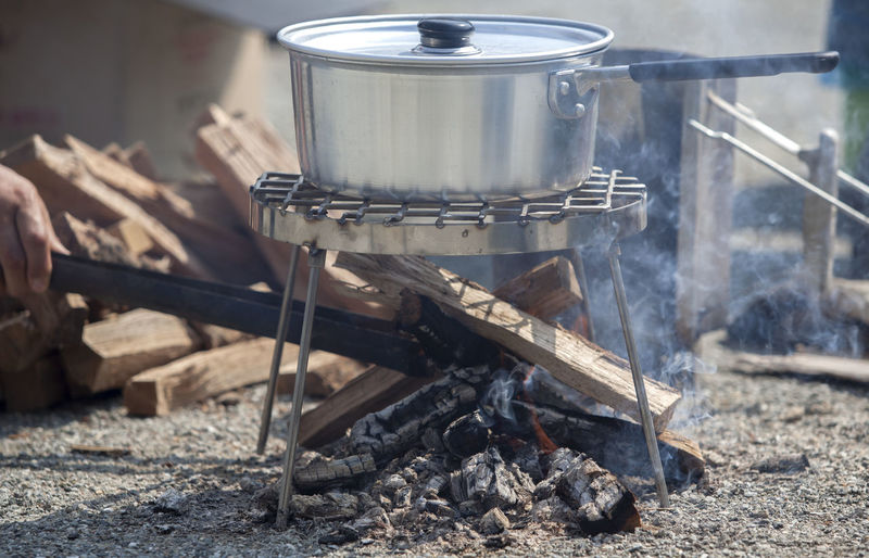 Cropped image of person cooking at campsite
