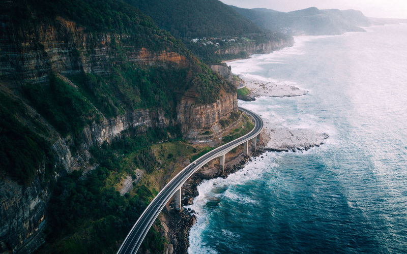 Aerial view of highway by sea