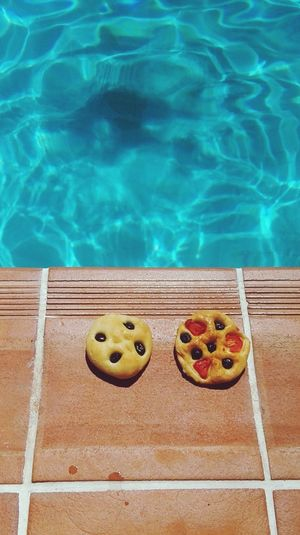 High Angle View Of Focaccia Breads At Swimming Pool During Sunny Day
