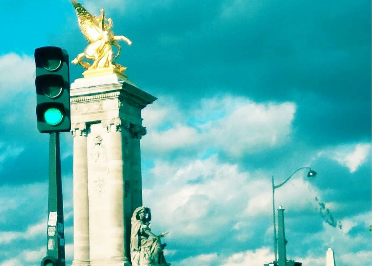 architecture, sky, cloud - sky, built structure, sculpture, building exterior, representation, statue, low angle view, travel destinations, nature, no people, travel, architectural column, art and craft, memorial, outdoors, tower, lighting equipment, monument, angel