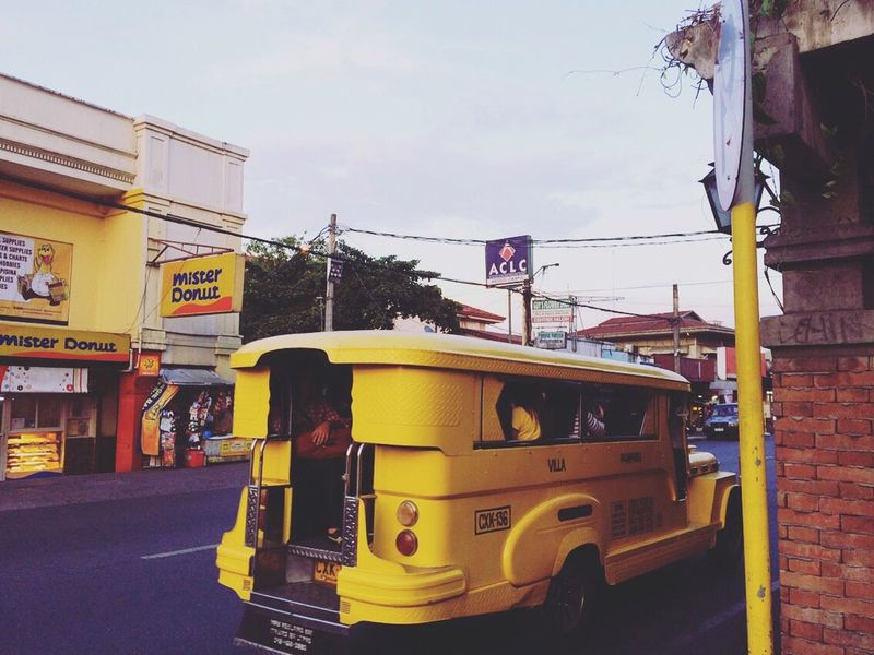 Jeepny - public transport in the Philippines Clark Pampanga Jeepny Philippines Yellow On The Road