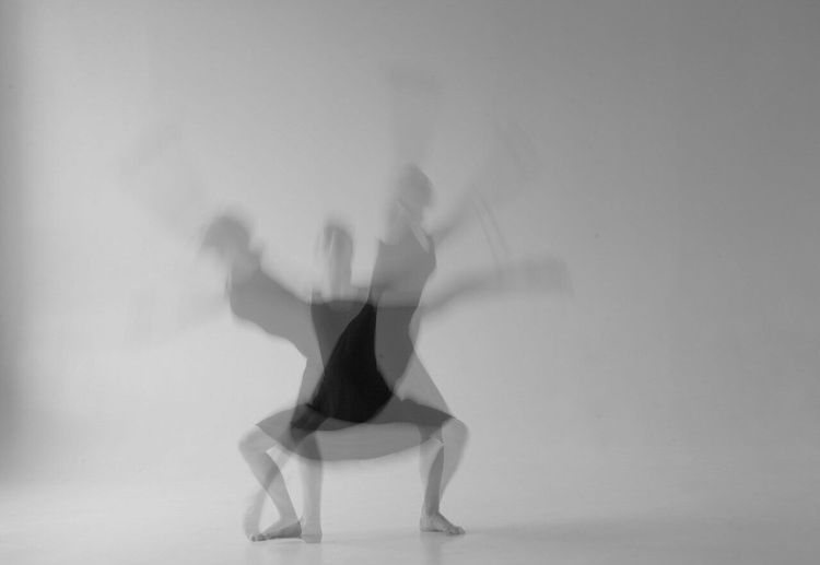 Multiple Image Of Woman Dancing Against Gray Background
