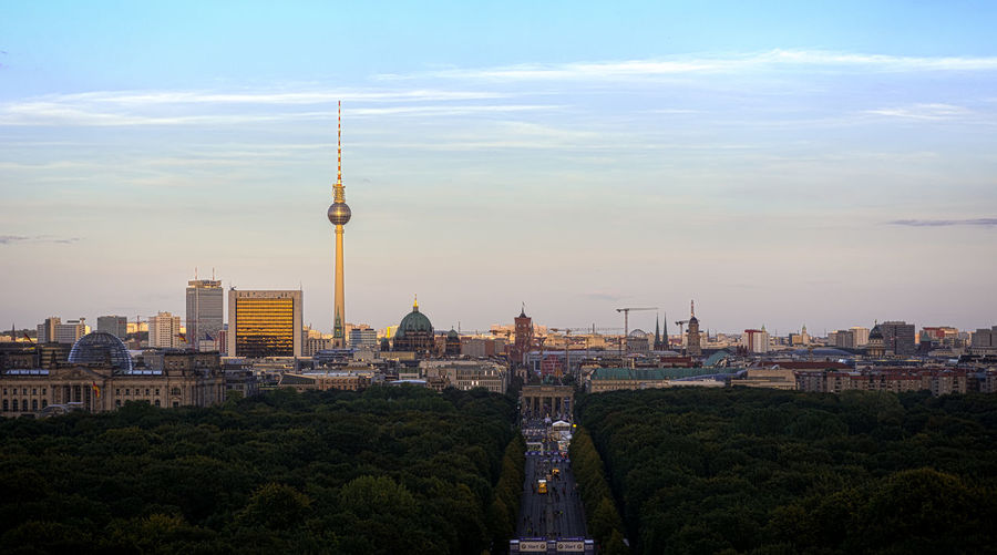 Fernsehturm And Cityscape By Tiergarten Against Sky