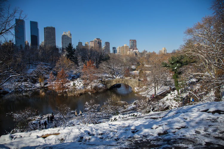 View of the Gapstow Bridge in Central Park during the Winter. Central Gapstow Bridge Architecture Beauty In Nature Bridge - Man Made Structure City Cold Temperature Frozen Nature Outdoors Snow Water Winter