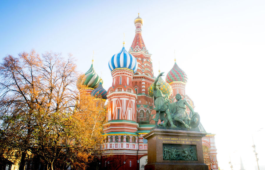 Architecture Blue Built Structure Capital Cities  Culture Cultures Day Famous Place High Section Low Angle View Moscow City No People Outdoors Place Of Worship Religion Russia Sky Spirituality St. Basil's Cathedral Temple Temple - Building Tourism Travel Destinations Tree