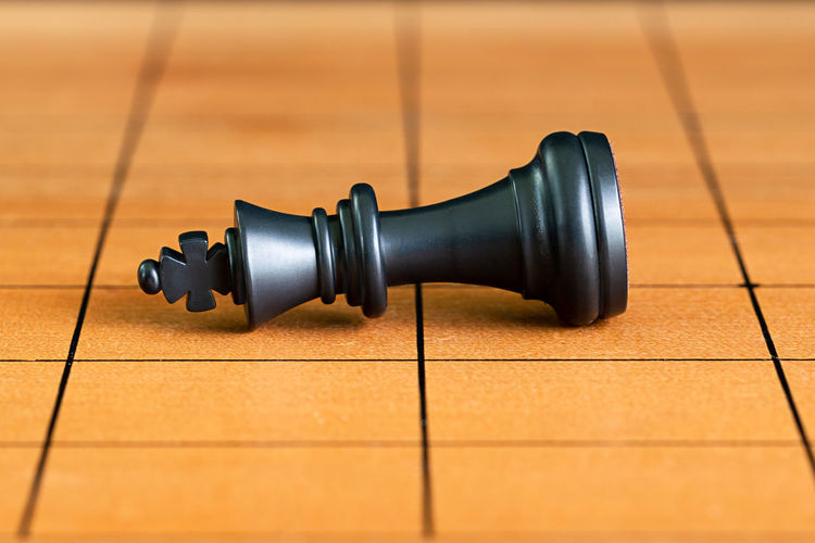 Chess pieces on a wood chessboard Flooring Indoors  No People Wood - Material Close-up Game Focus On Foreground Black Color Board Game Still Life Chess Piece Chess Single Object High Angle View Sport Arts Culture And Entertainment Leisure Games Tile Wood King - Chess Piece