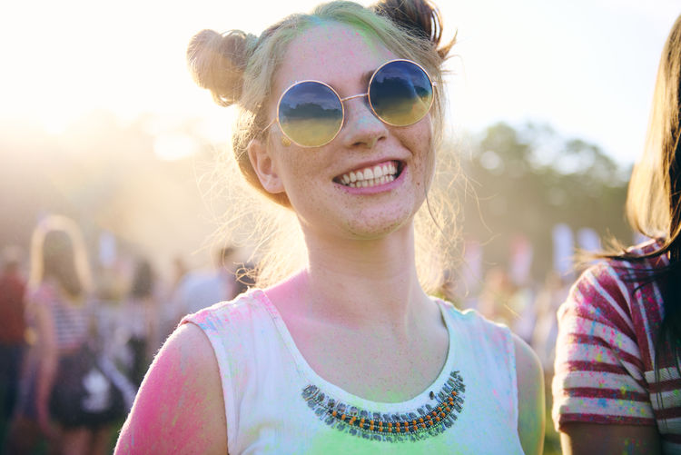Portrait of happy young woman at carnival