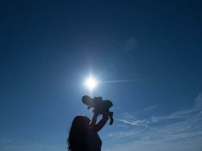Low angle view of silhouette woman against clear sky