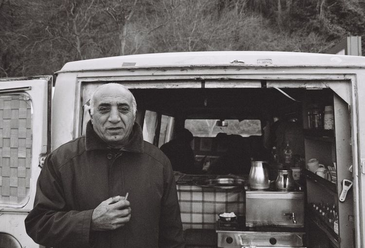 Portrait of man holding cigarette