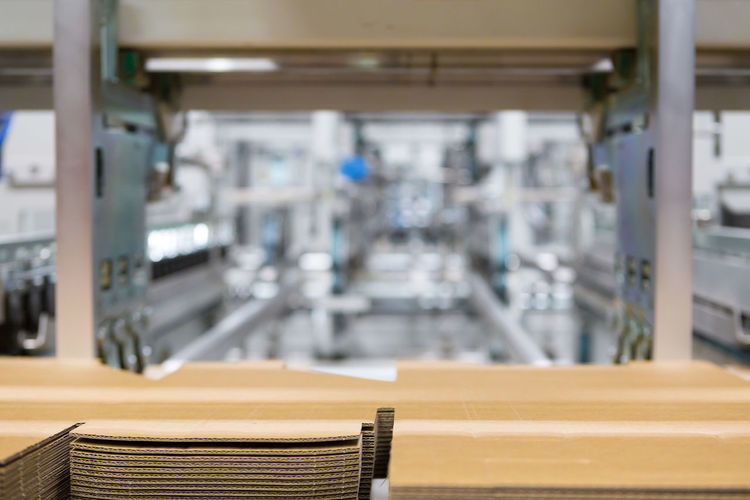 Printing and cutting packaging industry machine No People Indoors  Focus On Foreground Business Table Industry Wood - Material Factory Equipment Empty Container Food And Drink Absence Technology Food And Drink Industry Selective Focus Education In A Row Machinery Close-up Printing Cutting Board Industry Measuring Measurement Occupation Horizontal Packaging Industry Cardboard Warehouse
