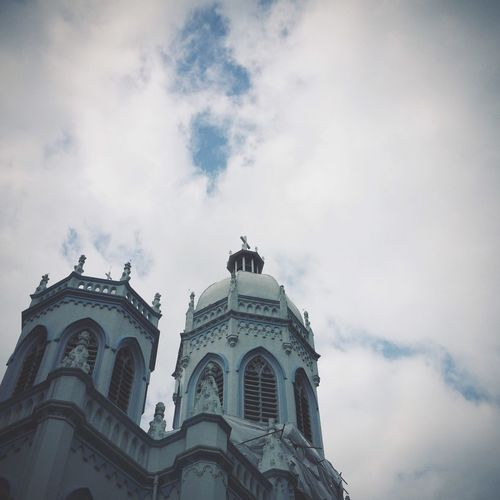 Low angle view of saint joseph church against cloudy sky