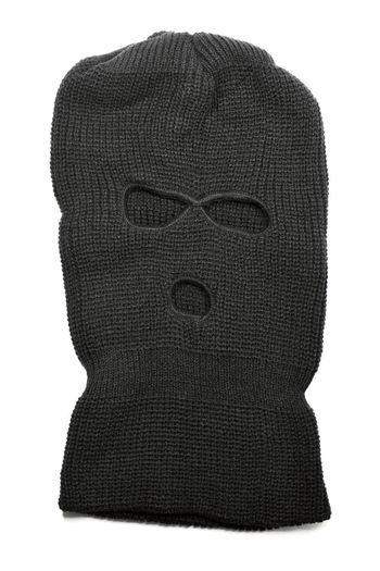 A Black ski mask aka Balaclava isolated on white with natural shadows.